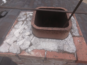 Terra cotta flue tile with rounded edges.
