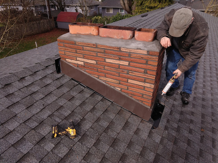 Flue tiles are level with one another and are very close together. Smoke can be pulled horizontally from one flue top and come down the adjacent flue.